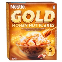 Хлопья Nestle Gold Flakes хрустящие кукурузные с медом и арахисом 300 гр